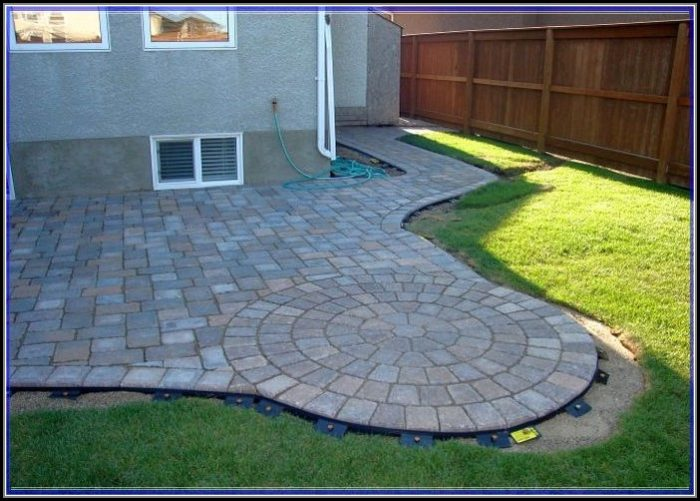 Interlocking Patio Tiles Over Grass
