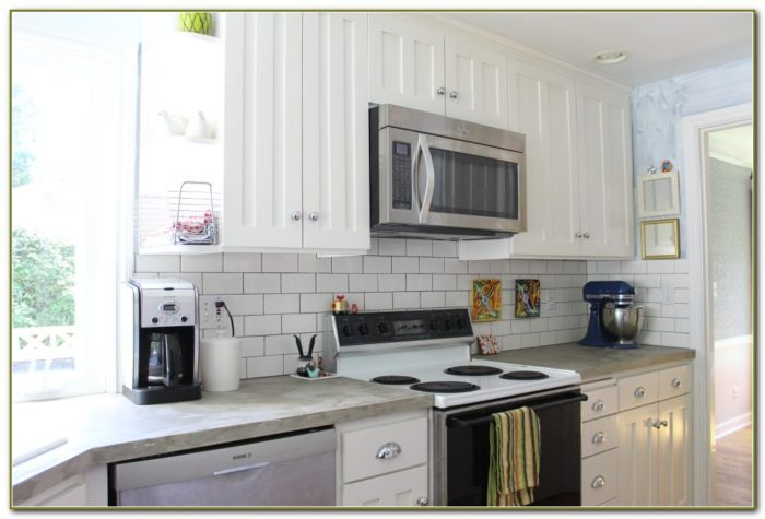 Glass Subway Tile Backsplash White Cabinets