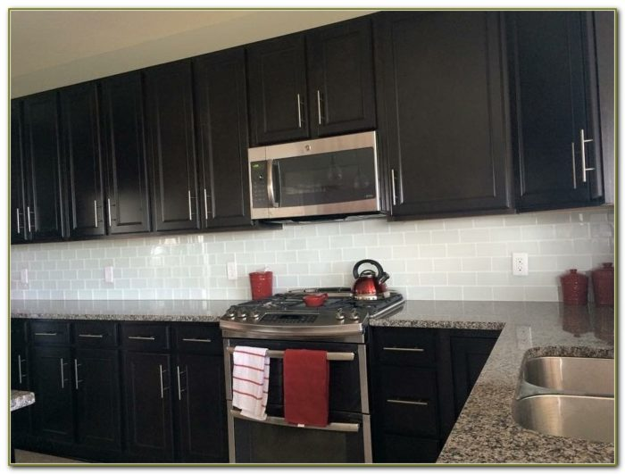 Glass Subway Tile Backsplash With Dark Cabinets