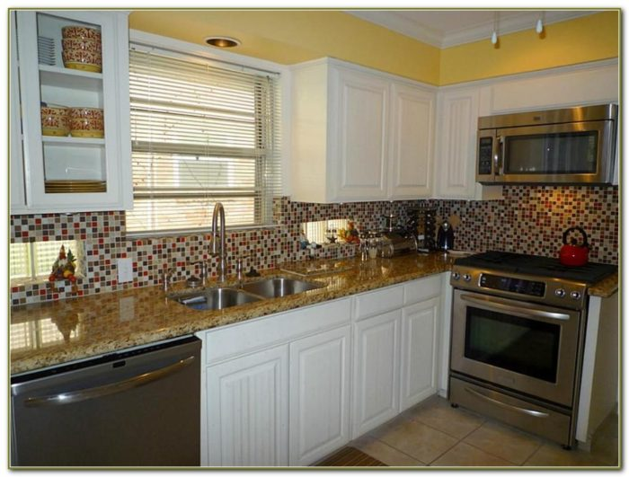 Glass Tile Backsplash White Cabinets