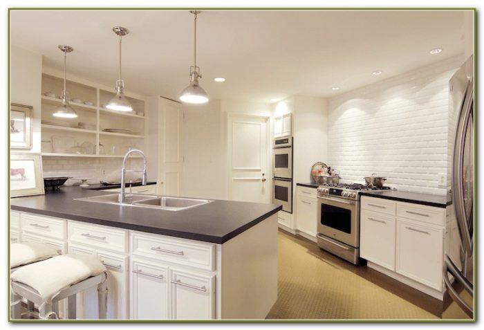 White Beveled Subway Tile Kitchen Backsplash