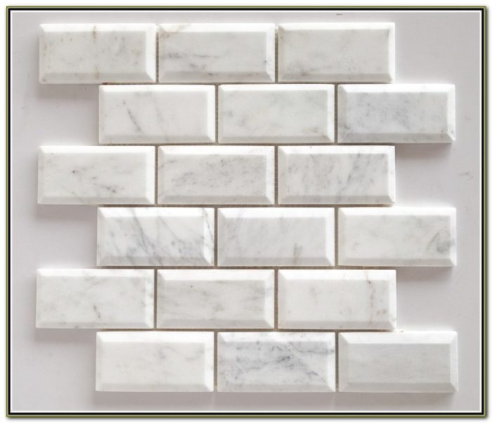 White Beveled Subway Tile With Grey Grout