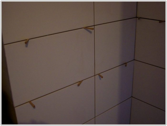 Large White Tiles Bathroom Wall