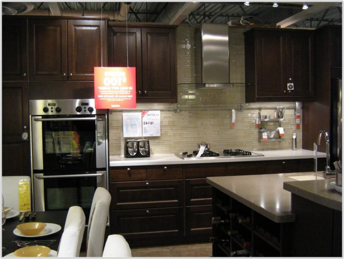 Subway Tile Kitchen Backsplash With Dark Cabinets