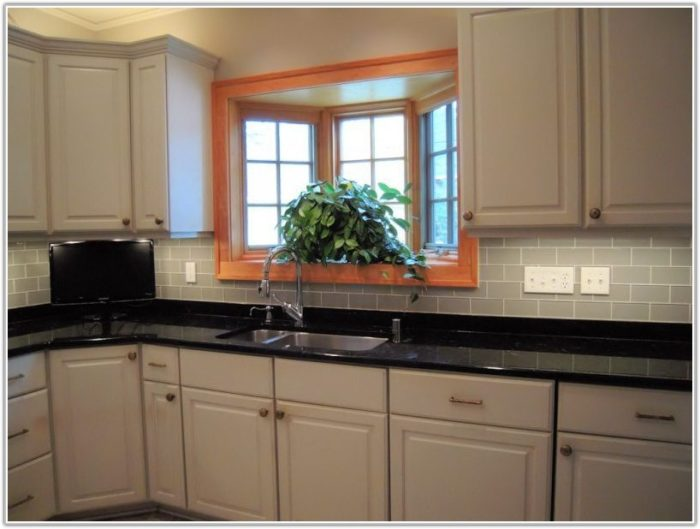 White Glass Tile Backsplash With Dark Cabinets